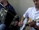 ComhaltasLive #241 - 5: Street session with Mick O'Connor at Fleadh 2007